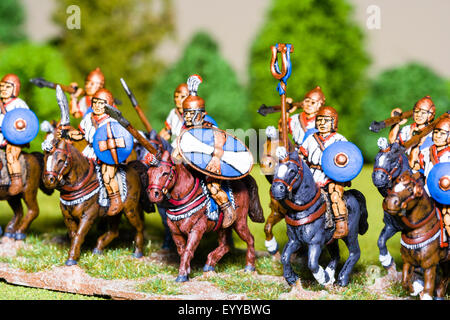 Close-up of metal painted model figures. Carthaginian cavalry charging. Table top war gaming. - Stock Photo