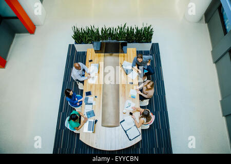 High angle view of business people working in office meeting - Stock Photo