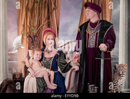 Medieval couple and child posing in living room - Stock Photo
