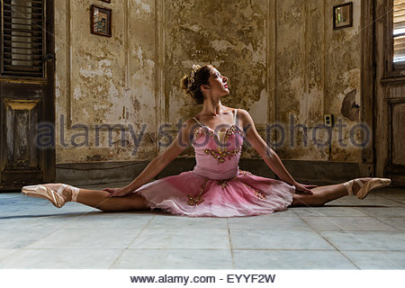 Hispanic ballet dancer posing in dilapidated mansion - Stock Photo
