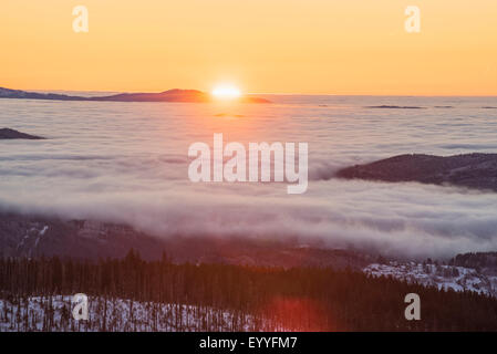 Sunset over mount Lusen in winter, Germany, Bavaria, Bavarian Forest National Park - Stock Photo