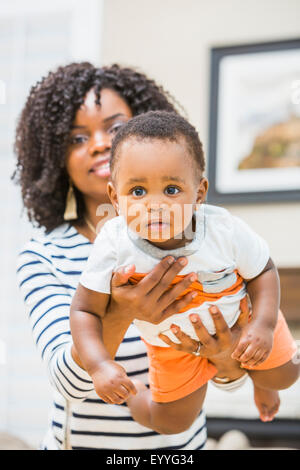 Close up of Black mother holding baby son