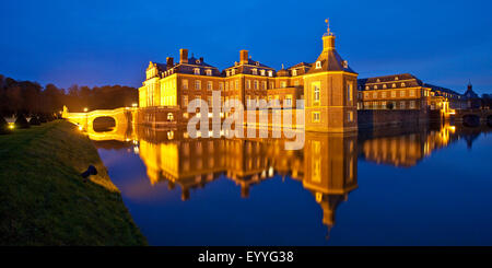 illuminated Castle Nordkirchen at blue hour, Germany, North Rhine-Westphalia, Muensterland, Nordkirchen - Stock Photo