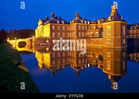 illuminated Castle Nordkirchen at blue hour, Germany, North Rhine-Westphalia, Muensterland, Nordkirchen - Stock Photo
