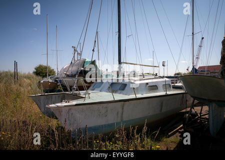 colour shot of Boats in boatyard at Tollesbury saltings on the Essex Coast - Stock Photo