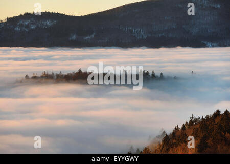 sunset over the clouds in winter, Germany, Bavaria, Bavarian Forest National Park - Stock Photo