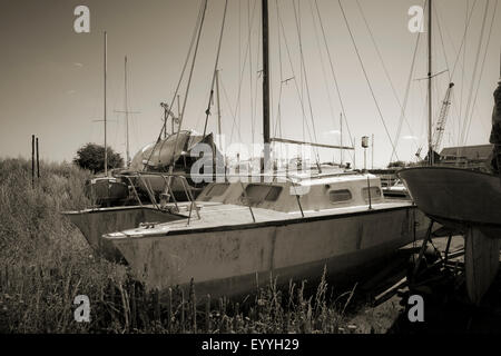 Sepia pivcture of Boats in boatyard at Tollesbury saltings on the Essex Coast - Stock Photo