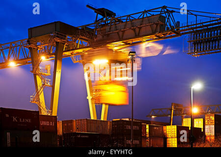 Dortmund Port with container gantry crane in the evening, Germany, North Rhine-Westphalia, Ruhr Area, Dortmund - Stock Photo