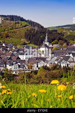 view to town and St. Heribert Church in spring, Germany, North Rhine-Westphalia, Sauerland, Hallenberg - Stock Photo