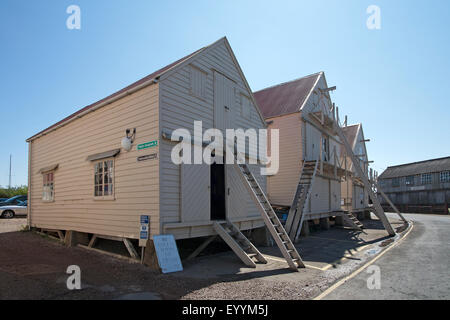The renovated wooden sail lofts at Tollesbury Saltings on the coast of Essex - Stock Photo
