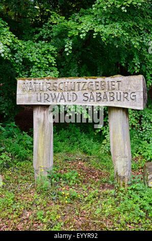 wooden nature reserve sign ancient forest of Sababurg, Germany, Hesse, Reinhardswald - Stock Photo