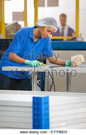 Technician worker cleaning and checking newly manufactured solar panels - Stock Photo