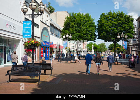 People walking around the shops stores town centre in summer Carlisle Cumbria England UK United Kingdom GB Great - Stock Photo