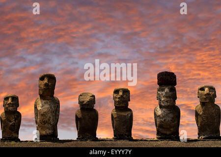 Moai statues at sunset, Chile, Rapa Nui National Park - Stock Photo