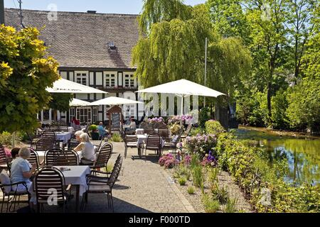 people in a garden cafe at the river Lenne district Saalhausen, Germany, North Rhine-Westphalia, Sauerland, Lennestadt - Stock Photo