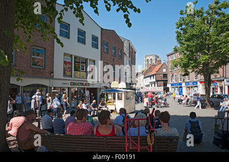 People visiting King's Square shops stores in summer York city town centre North Yorkshire England UK United Kingdom - Stock Photo