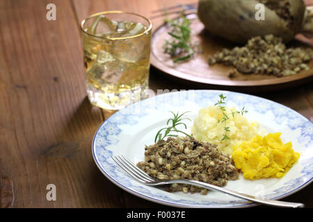 haggis neeps tatties and scotch whisky, scotland traditional food - Stock Photo