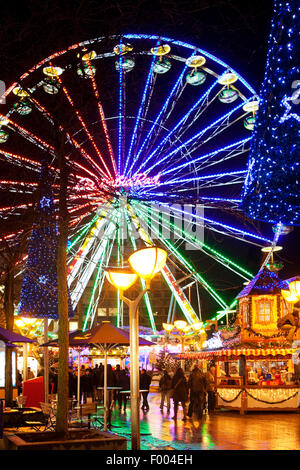 Christmas market with ferris wheel in the evening, Germany, North Rhine-Westphalia, Ruhr Area, Duisburg - Stock Photo