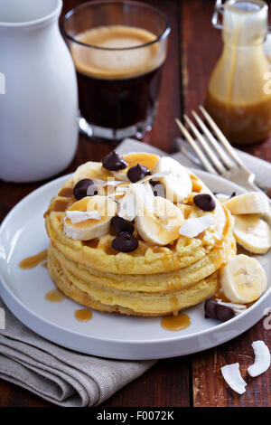 Waffles with banana slices, caramel and chocolate - Stock Photo