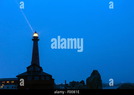 lighthouse of Andenes at night with snow fall, Vester�len, Insel And�ya, Andenes - Stock Photo