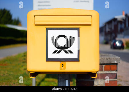 letter box with posthorn, Germany, Hamburg - Stock Photo
