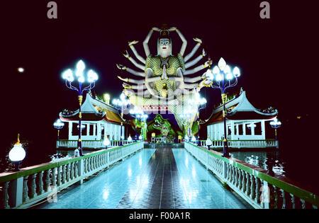 Guanyin Statue at Wat Plai Laem at night, Samui island, Thailand - Stock Photo