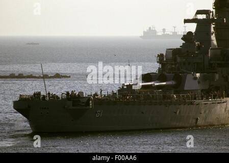Suez Canal, Egypt - 1988 --The US Navy battleship USS Iowa (BB61) and USS Ticonderoga transits the Suez Canal. - Stock Photo