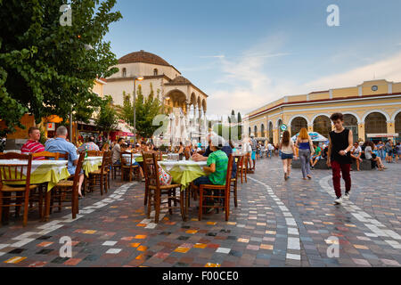 People in a restaurant at the mosque in Monastiraki square in Athens - Stock Photo