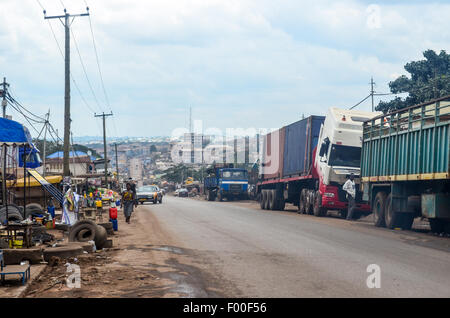 A street of Suame Magazine, in the suburbs of Kumasi, Ghana, a large industrial area where trucks from all over - Stock Photo