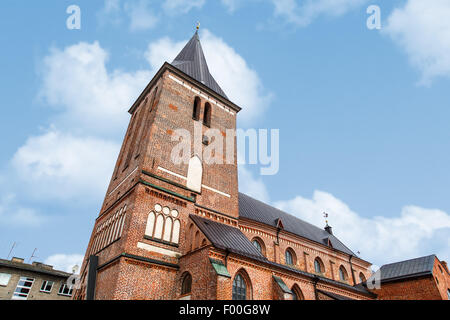 View of Evangelist Lutheran St John's Church in Tartu, Estonia from the 14th century, on coludy blue sky bakcground. - Stock Photo