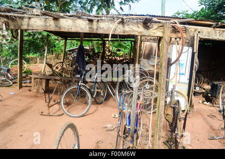 Local bicycle shop in the countryside of Ghana - Stock Photo