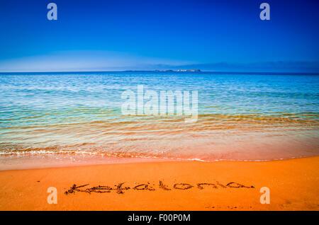 Kefalonia word written on Xi beach, Greece. Selective focus. - Stock Photo