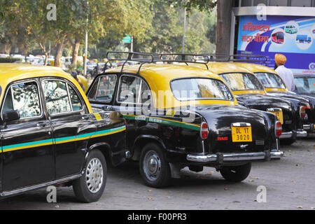 Ambassador taxi cabs at a stand in New Delhi. This vehicle type has long been a prominent feature in Indian towns - Stock Photo