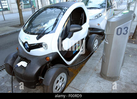 Electric hire cars including Renault Twizy at charging point in Bordeaux, France - Stock Photo