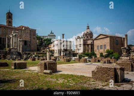 The Curia in the Roman Forum and the nearby church of Santi Luca e Martina. - Stock Photo
