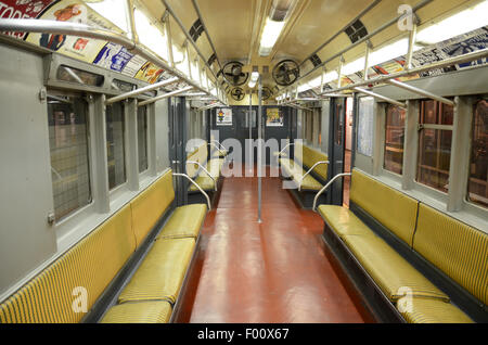 New York Transit Museum carriage subway vintage subway 1948 ceiling mounted fans yellow rattan benches seating seats - Stock Photo