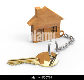 Golden key with wooden houses - Stock Photo
