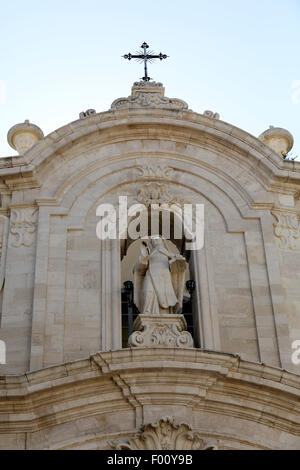 Sculpture of St Teresa on the St Teresa Church (Chiesa di Santa Teresa) in Trani, Italy. The church has a Baroque - Stock Photo