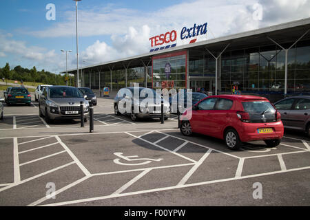 car parking disabled spots at tesco extra superstore at st helens uk - Stock Photo