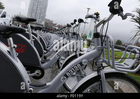 Belfast, Northern Ireland, UK. 5th August 2015. Belfast Bikes stand unused near Odyssey Arena on a wet August day. - Stock Photo