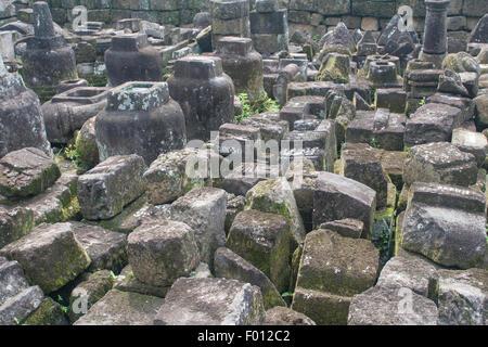 Jumble of stone blocks at the 9th-century Buddhist temple, Candi Mendut, of Java, Indonesia. - Stock Photo