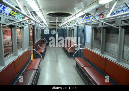 New York Transit Museum carriage subway vintage subway 1950 ceiling fans brown leather benches seating seats grey - Stock Photo
