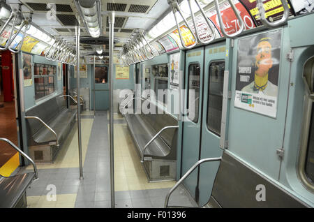 New York Transit Museum carriage subway vintage subway 1961; grey gray livery vintage adverts hand grip straps silver - Stock Photo