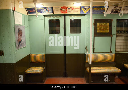 New York Transit Museum carriage subway vintage subway 1932/3 turquoise adverts cigarette gec tb x ray rattan seating - Stock Photo