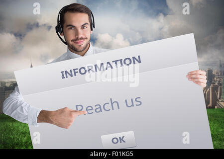 Composite image of businessman with headphone showing sign to camera - Stock Photo
