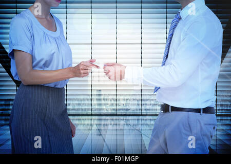 Composite image of business people exchanging business card - Stock Photo