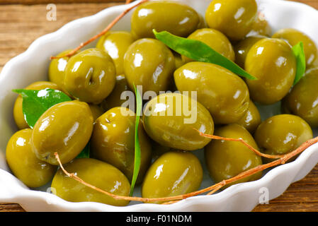 Fresh green olives in ceramic dish - Stock Photo