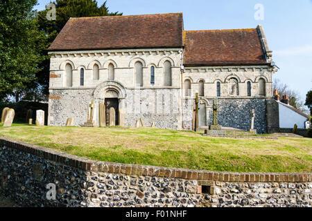 England, Barfrestone. Norman carvings. St Nicholas church. south main door with tympanum above - Stock Photo