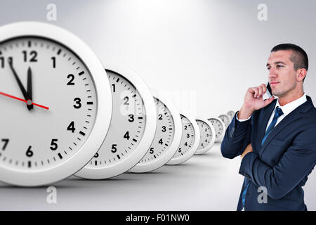 Composite image of businessman having phone call - Stock Photo