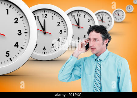 Composite image of businessman having phone call - Stock Photo